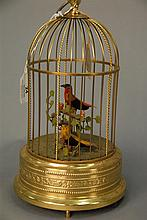 Singing bird in brass cage, 20th century. ht. 11in.