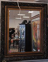Large contemporary mirror with gold frame. 53