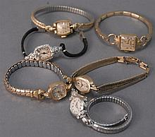 Group of six ladies 14K gold wristwatches.