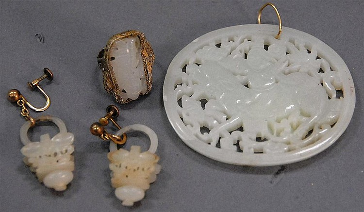Jade jewelry group to include a ring mounted with white jade figure, pair of jade earrings, and oval jade pendant with figure riding...