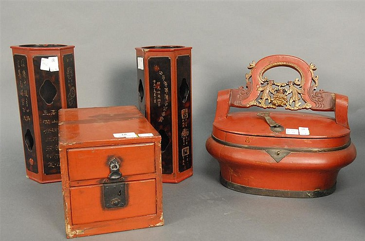 Four piece group of red and black painted pieces to include a lift top box with carved handle ht. 12in.; lg. 14in., pair of wood vas...