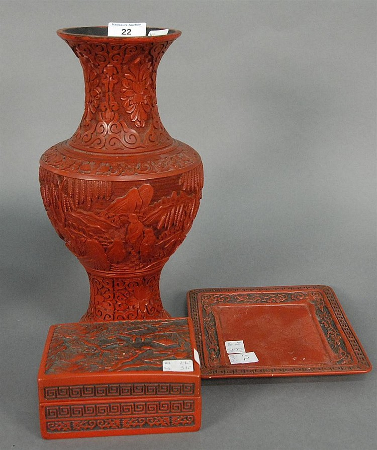 Three cinnabar pieces; baluster form vase with carved landscape scene ht. 13in., covered box with landscape scene 5 1/4