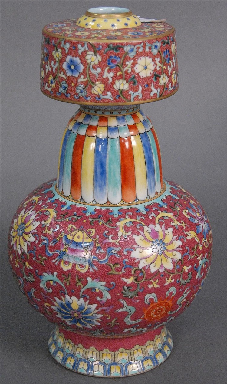 Famille rose double gourde vase with rose ground and scrolling wild flowers having Qianlong mark on bottom, ht. 10 1/2in.