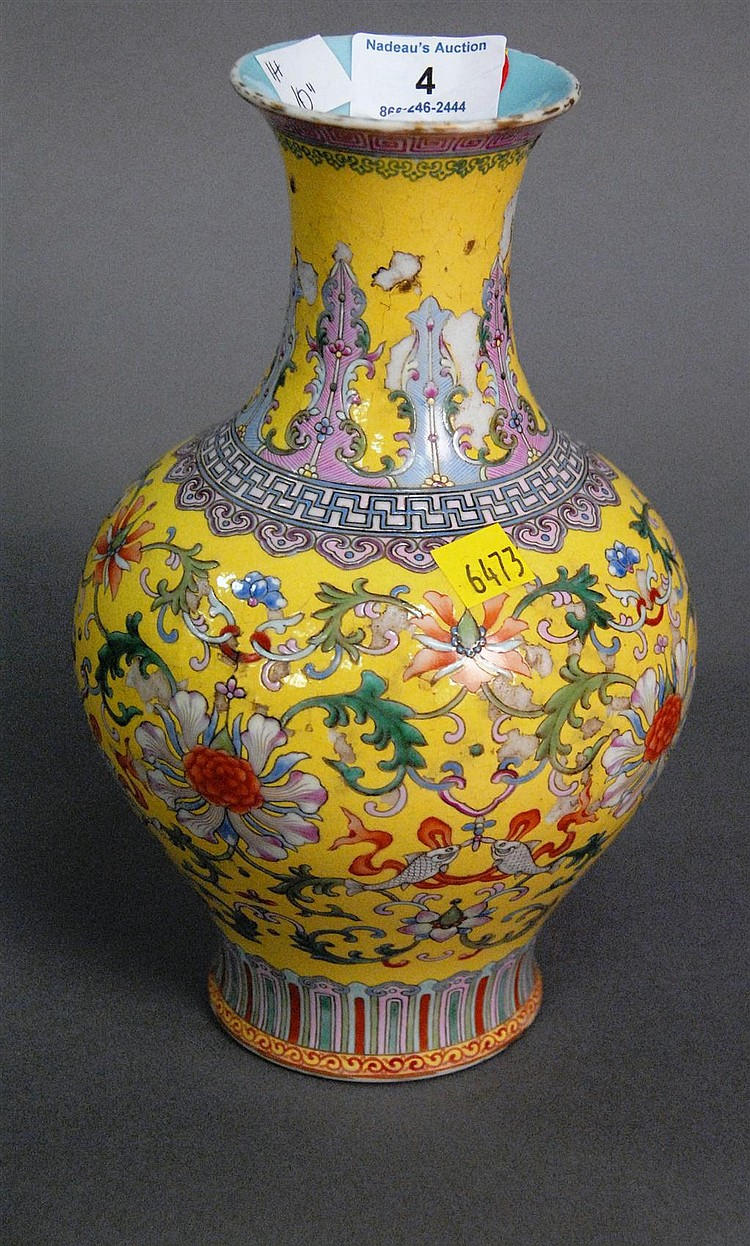 Famille rose yellow ground vase having scrolling vines and flowers with Qianlong mark on bottom (as is condition).