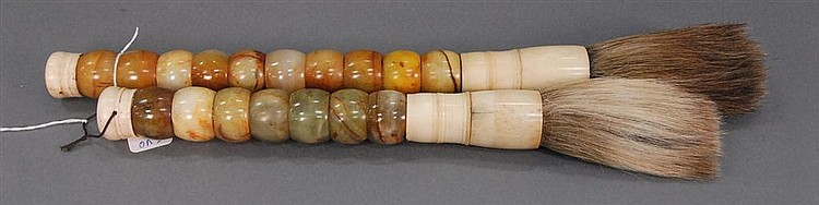 Pair of bone and hard stone brushes made up of rings, hard stone, and bone, lg. 11in. & 14in.