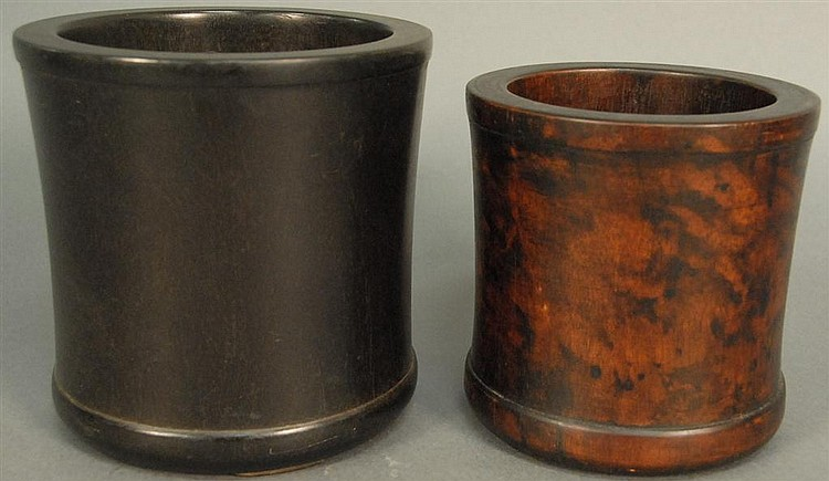 Two hardwood brush pots, ht. 6in.; dia. 6in. & ht. 7in.; dia. 7in.
