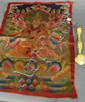 Two piece lot to include an enameled scepter with scrolling flowers lg. 11 1/2in. and embroidered cloth with a seated Buddha.