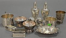 Large group of sterling silver to include salt and pepper shakers, shot pourer, nut dish, cup, and napkin rings, 15 t oz.