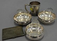 Five pieces of sterling silver to include three porringers, handled mug, and Volupte sterling cigarette holder, ht. 3 1/2 in.; 21.7...