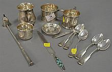 Group of sterling to include four mugs, enameled letter opener, set of six spoons, candle snuffer, etc.; 17.7 t oz. weighable silver
