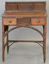 Victorian oak and wicker desk having two drawers and wicker letter holders. ht. 37 in.; wd. 28 in.