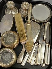 Box lot of weighted sterling pieces to include eleven knives, eight ash trays, pair of candlesticks, two mirrors, and two brushes.