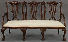 Chippendale style mahogany triple chairback settee. lg. 76 in.