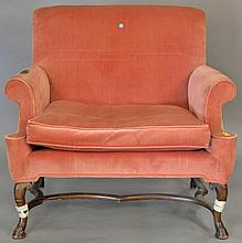 Continental style loveseat with hoof feet and stretcher base, wd. 40 in.