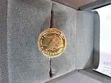 Bague en or jaune sertie une monnaie de 10 F or de 1862. Poi