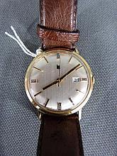 Montre bracelet LIP en or avec bracelet en cuir d'autruche e