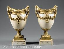 Pair of French Gilt Bronze Mounted Marble Urns