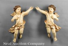 Italian Carved, Polychromed and Gilt Wood Putti