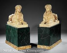 Pair of Italian Carved Travertine Sphinxes