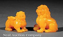 Two Chinese Yellow Glass Figures of Lions
