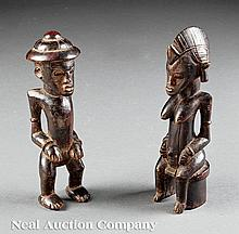A Pair of Turka Stained and Carved Wood Figures