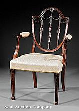 A George III Carved Mahogany Armchair