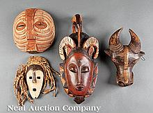 A Collection of Four African Carved Wood Masks