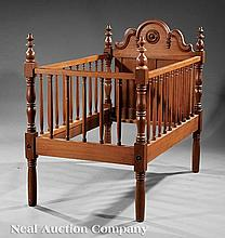 An American Carved Walnut Crib