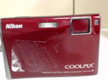 Nikon Coolpix S60 10MP Digital Camera. 5X  Optical Zoom. In good condition with some  scratches from use, missing battery and  battery charger,  Functionality Unverified