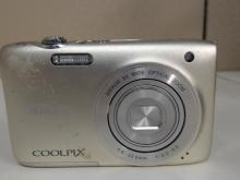 Nikon Coolpix S3100 14.0 MP Digital Camera.  5X Wide Optical Zoom. In decent condition  with sticker residue on front and on screen.  Missing battery charger,  Functionality  Unverified