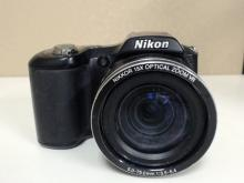 Nikon Coolpix L100 10.0 MP Digital Camera.  15X Optical Zoom. In good condition with some  wear from use, needs 4 AA Batteries and an  SD card, Functionality Unverified