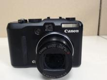 Canon PowerShot G9 12.1 MP Digital Camera. 6X  IS Zoom Lens. In good condition with some  wear from use, missing battery and charger.   Functionality Unverified