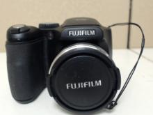Fujifilm FinePix S700 7.1 MP Digital Camera.  10X Optical Zoom. In good condition with some  wear from use, needs 4 AA batteries and SD  card,  Functionality Unverified