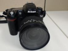 Nikon D80 10.2 MP Digital SLR Camera with  Nikon Nikkor 24-120mm Lens. In good condition  with some wear from use, lens has small  crack on it, missing battery charger, powers  on, unknown if display screen works.