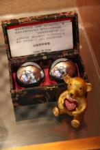 Chinese Stress Balls With Gold Colored Pill Bear