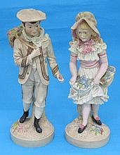A pair of bisque porcelain figures, of a boy and
