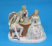 A Dresden porcelain figure group, of two seated