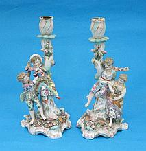 A pair of Sitzendorf porcelain candlesticks, with