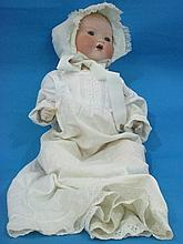 An Armand Marseille doll, with sleeping eyes and