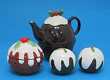 A Novelty four piece tea pot, two cruets and a