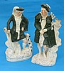A pair of Staffordshire figures of Scotsmen, with