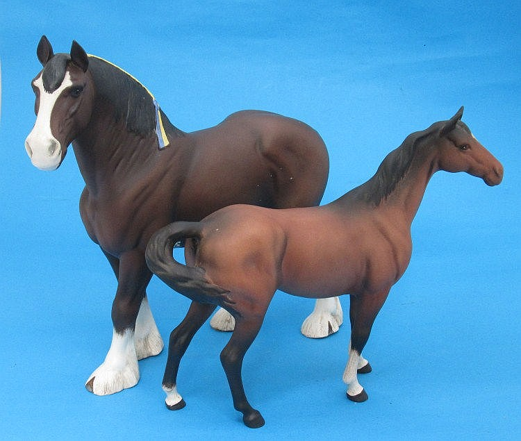 A Beswick model of a shire horse with blue and