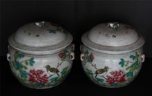 PAIR OF CHINESE PORCELAIN FAMILLE ROSE LIDDED JARS