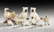 Collection of Nine Pottery and Porcelain Pug Dogs