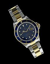 Stainless Steel and 18 Kt. Rolex Submariner Watch