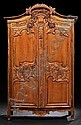 Provincial Louis XV-Style Pine Armoire, mid-19th century, the domed, C-scroll- and foliate-carved crest above a case fitted with a floral-basket-centered frieze over two long doors, each with floral carving, inset with two shaped panels divided by a
