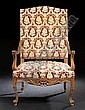 Louis XIV-Style Carved Fruitwood Fauteuil a la Reine, late 19th century, the slightly domed and padded back joined to the padded seat by downswept foliate-carved and incised arms, above a foliate-carved apron, raised on cabriole legs ending in