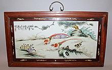 A CHINESE HARDWOOD FRAMED PORCELAIN PANEL