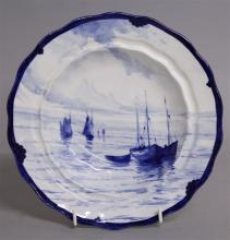 A ROYAL CROWN DERBY SOUP PLATE, painted with boats