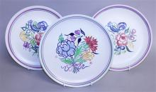 A PAIR OF POOLE POTTERY CIRCULAR PLATES decorated